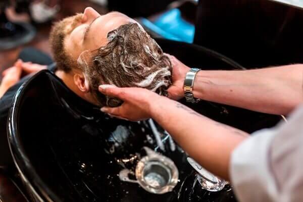 Man getting his hair shampooed