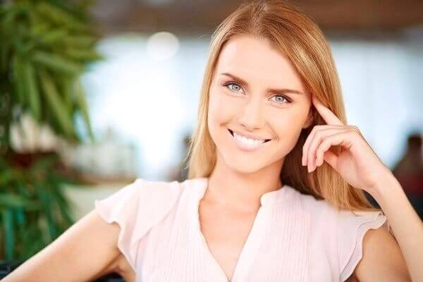 Happy woman with shiny and smooth hair